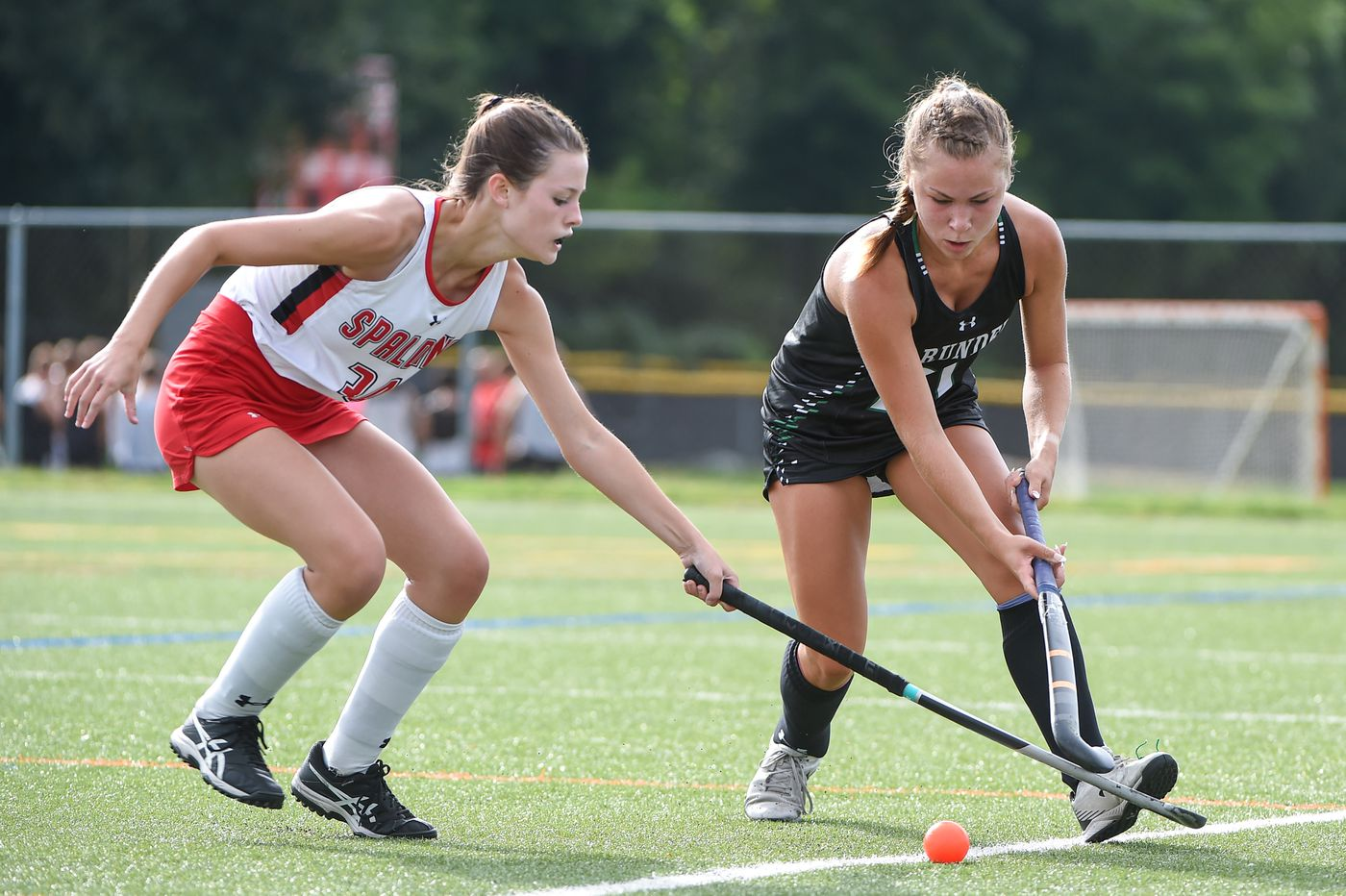Elly Beavers (34) from Spalding and Christina Candella (21) from Arundel fight for ball control in the 2nd period.  Archbishop Spalding will host field hockey at Arundel High School on Thursday, September 10, beating them 5-1 in regular time.  09.09.21