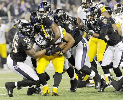 Ravens defenders work to stop running back Isaac Redman in the second half of the Ravens' 23-20 loss to the Pittsburgh Steelers at M&T Bank Stadium in Baltimore Sunday.