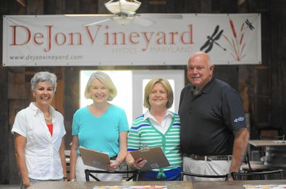 Sara Tompkins, of Cockeysville, from left to right, president of The Republican Women of Baltimore County, co-chair Donna Mell, of Timoniun, Patty Ensor, of Phoenix, and Bill Ensor, of Phoenix, go over details for RWBC's fundraiser at DeJon Vineyards in Hydes, Vineyard and Valor, benefitting Feherty's Troops First Foundation's Leroy Petry Village of Honor. The event is scheduled for Sept. 20 from 3 p.m. to 7 p.m.