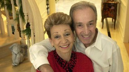 Shown with his wife Angie, John Guerriero, founder of Continental Foods, once drove a station wagon to serve his restaurant clients. The leader in the Little Italy neighborhood died Monday at age 86.