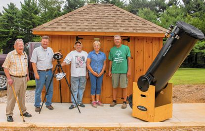 From left, Bob Clark, from the Westminster Astronomical Society; Steve Miller, Manchester town manager; Vince DePalmer and wife Pat Griffith, bocce ball fundraiser hosts; and Bill Skinner, project manager, stand with the Galileo telescope, left, and the Discovery telescope at the nature center Aug. 10. _- Original Credit: Coryn Diehl/submitted photo