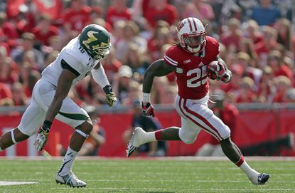 Wisconsin running back Melvin Gordon (25) runs for a gain in the fourth quarter against South Florida.