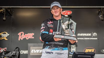 Bryan Schmitt of Deale holds the championship trophy after winning theFishing League Worldwide Tour at the Mississippi River on Sunday in La Crosse, Wis.