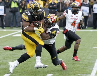 Iowa running back LeShun Daniels absorbs contact from Maryland defensive back Alvin Hill during their game Oct. 31, 2015, at Kinnick Stadium.