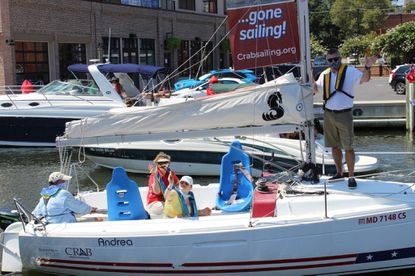 From left to right, Brad LaTour, Chesapeake Region Accessible Boating President, Dept. of Disabilities Secretary Carol Beatty, Emma Adams and her father Jonathan Adams, enjoy a sail on Sunday in celebration of 30 years since the Americans with Disabilities Act being signed. - Original Credit: