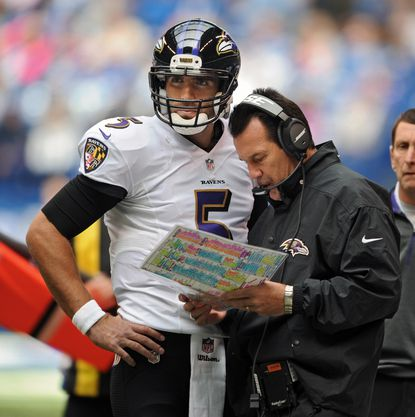 Ravens quarterback Joe Flacco, left, meets with offensive coordinator Gary Kubiak in the first quarter of the team's loss to the Indianapolis Colts. Flacco has throw four interceptions in the past two games.