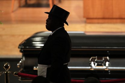 A member of the Most Worshipful Prince Hall Grand Lodge of Maryland walks by the casket of the late U.S. Rep. Elijah Cummings during a viewing service at Morgan State University last month. Many people don't have a plan for when they die.