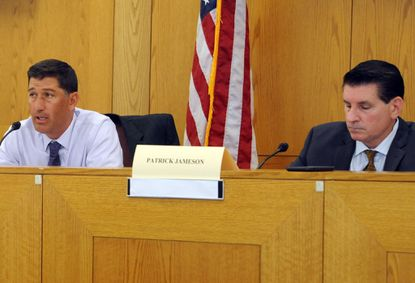 Patrick Jameson, right, executive director of the Medical Cannabis Commission, is shown at an August commission meeting with panel chairman Brian Lopez.