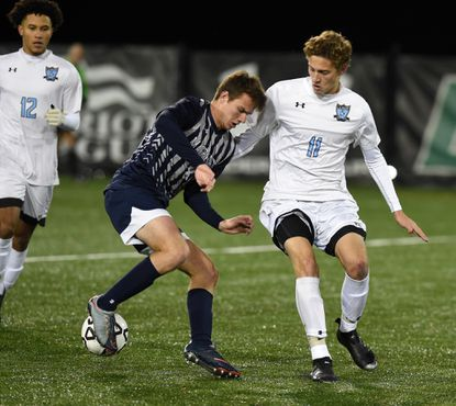 C. Milton Wright's Ethan Dolezal stays close and ready on defense as Magruder's Evan Koehn tries some fancy footwork during Saturday's Class 3A state soccer championship game at Loyola University's Ridley Athletic Complex in Baltimore.