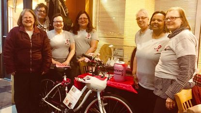 Members of Bosom Buddies of Carroll County at the bike raffle held on April 9 at Ledo Pizza in Westminster. From left to right are Diane Green; Linda Toth; Dawn Weeks; Tabatha Knoyer; Janet Sanders; Sharon Howell; and Lou Ann Snyder.