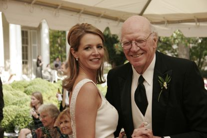 In this Sept. 30, 2006, photo provided by Mark C. Jenkins, is Ray Jenkins, right, and his daughter, Nancy Chafin, at her wedding in Richmond, Va. Ray Jenkins, a Pulitzer Prize-winning journalist who worked as a special assistant for press affairs in President Jimmy Carter's administration, has died at age 89. Jenkins' son Mark Jenkins says his father died Thursday, Oct. 24, 2019, at his home in Baltimore from congestive heart failure. (Mark C. Jenkins via AP)