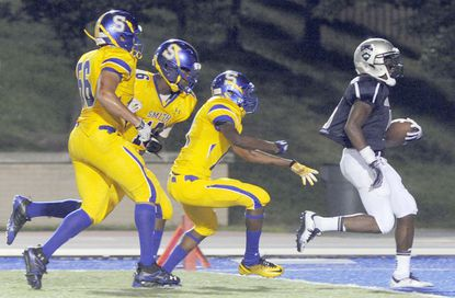 Gilman's Cyrus Jones outruns Oscar Smith defenders Troye Harris, Kaniya Anderson and Jaylen Bradshaw to score in the first half.
