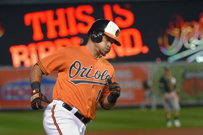 Orioles' Gerardo Parra rounds the bases with a solo home run to tie the Oakland Athletics at Camden Yards.