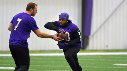 Ravens practice squad quarterback Josh Woodrum hands the ball off to running back Terrance West. The Ravens practiced on a short week as they prepare for the Colts.