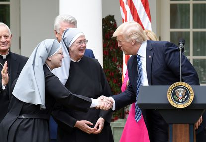 President Donald Trump greets the Little Sisters of the Poor before signing the Executive Order on Promoting Free Speech and Religious Liberty during a National Day of Prayer Event.