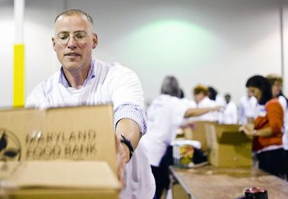 "A group of more than 200 volunteers packaged more than 9,500 meals for the needy for the holidays during the annual Elect to End Hunger event Oct. 27 According to the Maryland Food Bank, the state has more than 460,000 ""food-insecure"" or hungry people."