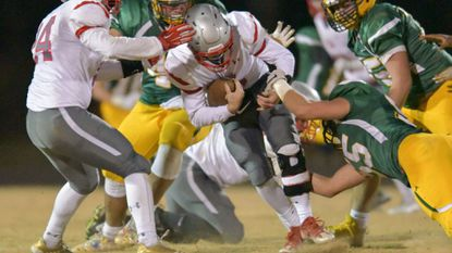 Glenelg quarterback Tyler Reiff is sacked for a loss in the first half. The Gladiators fell to host Damascus, 42-7, in a 2A state semifinal game on Friday, November 24, 2017.