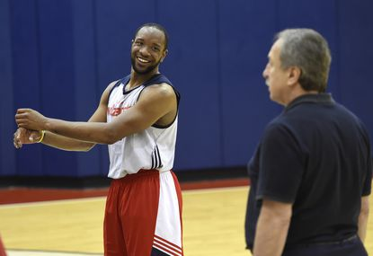 Maryland guard Dez Wells talks with Wizards GM Ernie Grunfeld during the Washington Wizards pre-draft workouts at the Verizon Center on June 11, 2015 in Washington, DC.