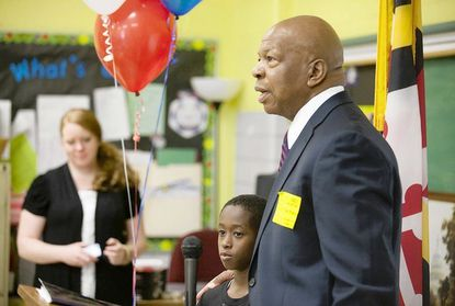 Hillcrest Elementary School fifth-grader Kechaun Colbert stands with U.S. Rep. Elijah Cummings after serving as emcee for Cummings' Tuesday morning presentation. The Maryland congressman told students at the Catonsville elementary school that he had been in a special education program from kindergarten until sixth grade. Colbert was also in the special education program at Hillcrest, but recently transitioned into the general education track.
