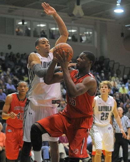 Loyola's Erik Etherly, left, defends Fairfield's Maurice Barrow in Friday night's game at Reitz Arena.