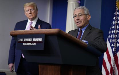 President Donald Trump listens as Director of the National Institute of Allergy and Infectious Diseases Dr. Anthony Fauci speaks during a coronavirus task force briefing at the White House, Friday, April 10, 2020, in Washington. (AP Photo/Evan Vucci)