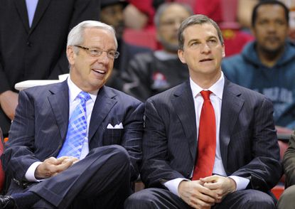 Tar Heels coach Roy Williams and Terps coach Mark Turgeon sit and talk before a game between Maryland and North Carolina.