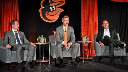 Louis Angelos, left, and his brother John Angelos, right, with Mike Elias, whom they selected as the Orioles executive vice president and general manager.