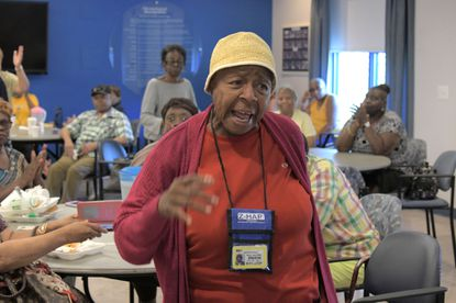 Zeta Healthy Aging Partnership member Ella Scovens, 79, reacts to proposed SNAP benefit restrictions during an press conference in Baltimore.