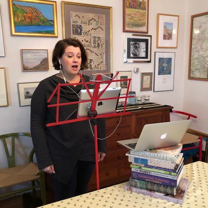 Kerry Holohan, a full-time freelance vocalist whose gigs include singing for St. David's and the Baltimore Choral Arts Society, performs at home.