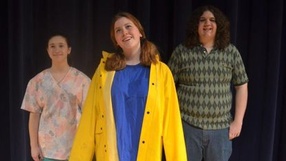 """Hannahlore Debenham, center, smiles during an imaginative moment in """"The Yellow Boat"""" by David Saar, which will be one of the one acts directed by students at Manchester Valley this spring."""