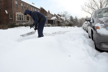 Richard Sigai, Mayfield, shovels snow from the latest winter storm on the sidewalk outside his home in the 3600 block of Crossland Avenue.