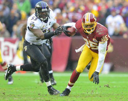 Ravens linebacker Jameel McClain attempts to grab Washington Redskins receiver Leonard Hankerson.