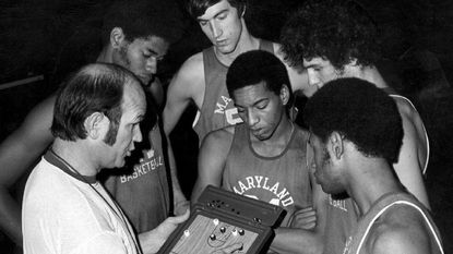 In 1973, Maryland coach Lefty Driesell discusses plays with, from left, Len Elmore, Tom McMillen, Maurice Howard, Tom Roy, and John Lucas.