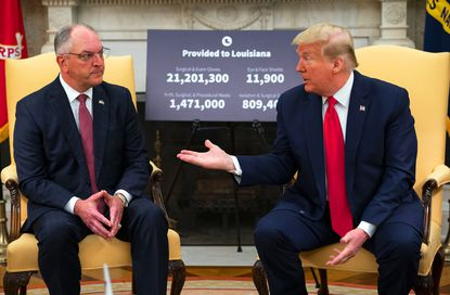 President Donald Trump talks with Louisiana Gov. John Bel Edwards in the Oval Office of the White House in Washington, Wednesday, April 29, 2020.