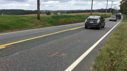 Traffic heads north on Norrisville Road in northern Harford County Wednesday afternoon in the vicinity of where a 16-year-old North Harford High School student running for his school was struck and killed by an SUV early Tuesday morning.