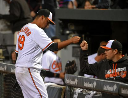 Orioles starter Yovani Gallardo gets a fist bump from Chris Tillman after retiring the Minnesota Twins in the fifth inning at Oriole Park at Camden Yards on Wednesday, April 6, 2016.