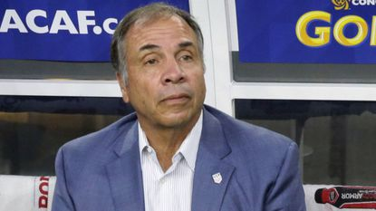 U.S. coach Bruce Arena sits on the bench prior to a CONCACAF Gold Cup match against Costa Rica on July 22, 2017, in Arlington, Texas. The New England Revolution have hired Arena as their coach and sports director.