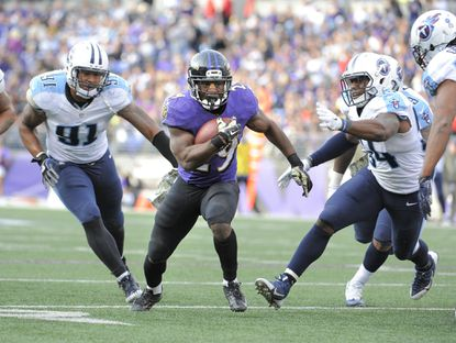 Ravens running back Justin Forsett scores a third-quarter touchdown against the Tennessee Titans.