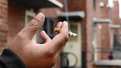 """""""Once you pay your money and sign your lease, you should be able to smoke,"""" said Chris Lewis outside Perkins Homes."""