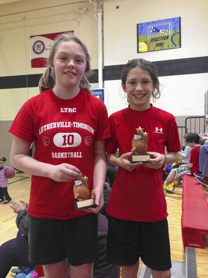 Grace Black and Chiara Menegatti were runnerup and winner of a recent basketball shootout at Ridgely Middle School.