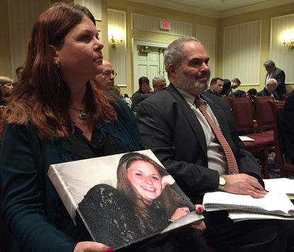 Laura Christian holds a photo of her daughter, Amber Marie Rose, who died at 16 in a 2005 car accident that involved a faulty ignition switch that was not recalled for another nine years.