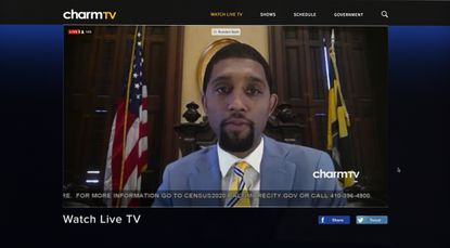 Baltimore City Council President Brandon Scott presides over the council's first virtual meeting from the chamber on April 6.