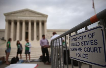 People gathered in front of the U.S. Supreme Court in Washington, D.C. File.