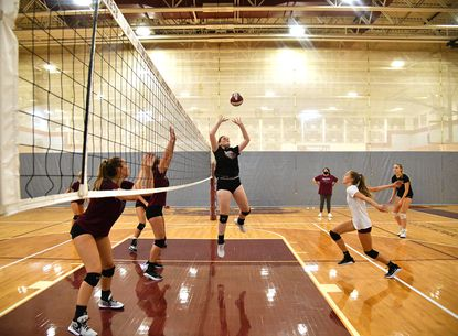 Broadneck senior Natalie Luscomb sets the ball during practice on Aug. 25. Luscomb is the top returning player for the Bruins, who are ranked No. 1 preseason.