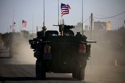 A convoy of U.S. forces drives near the village of Yalanli, on the western outskirts of the northern Syrian city of Manbij last year.