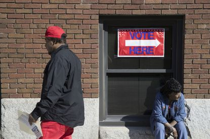 In this Oct. 12, 2016, file photo, voters mill about as early voting begins outside the Hamilton County Board of Elections in Cincinnati.