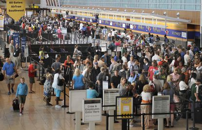 Travelers wait to pass through security at BWI Thurgood Marshall Airport.