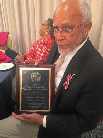 The Rev. Douglas Sands, of White Rock Independent Episcopal Methodist Church, shows displays an award the NAACP presented to the church on Friday, Oct. 21, 2016.