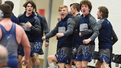 Manchester Valley wrestlers celebrate after teammate Nate Renfro defeats Tuscarora's Matt Hopkins in the 220 weight class during the semifinals of the Class 4A-3A West regional duals wrestling tournament at Linganore High School Feb. 6, 2019.