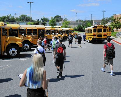 Bel Air High School students make their way to the buses atthe end of the first day of school Monday. With the new school year underway local police are advising drivers to be aware of students on streets and sidewalks as well as buses making stops on roads.
